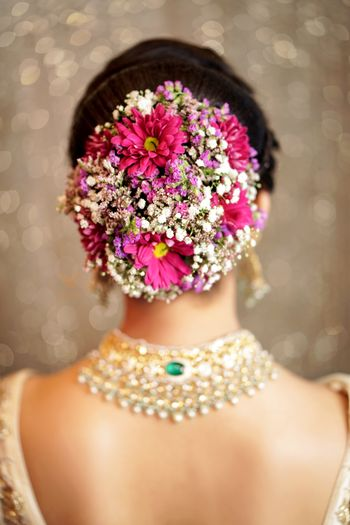 Unique bridal bun with flowers