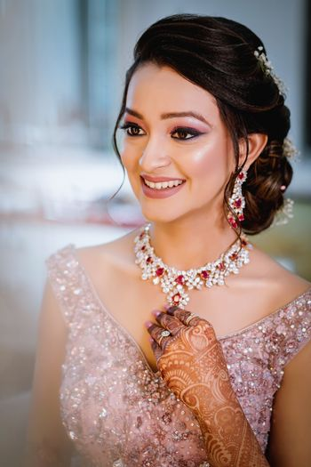 Photo of Glowing makeup with side bun for sangeet