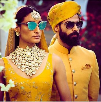 Matching Sabyasachi looks for bride and groom in yellow