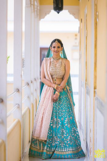 Photo of Turquoise and off white bridal lehenga