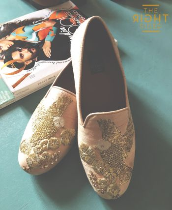 Photo of cream loafer shoes