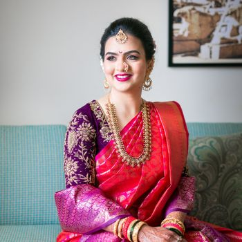 Gorgeous Maharashtrian bride in red nauvari and purple blouse & shela