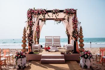 A floral mandap setup by the sea side
