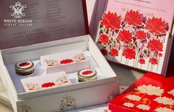 Photo of Wedding card with lotus motif and favour box