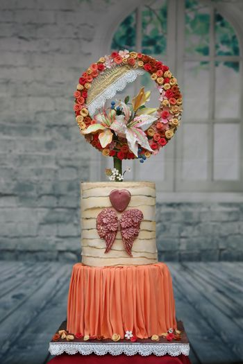 Pretty engagement cake with floral cake topper