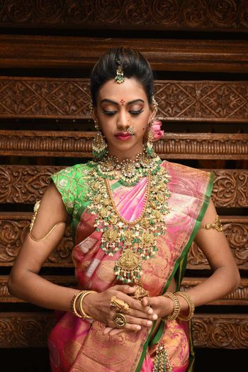 Stunning south indian bridal necklace with pink and green kanjivaram saree