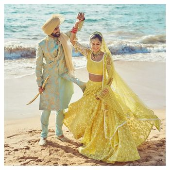 Photo of Pastel bride and groom outfits mint and yellow