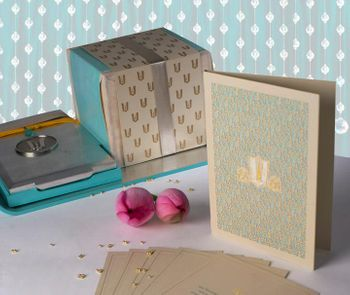 Photo of blue and gold wedding card