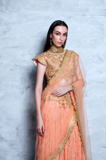 Photo of peach and gold lehenga