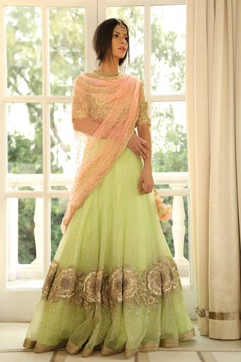 Photo of Light green and peach sequin work lehenga