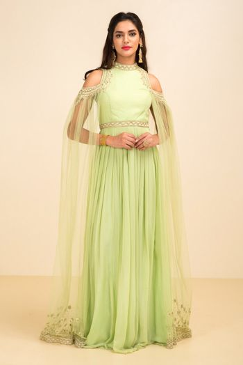 Photo of Light green cold shoulder anarkali with cape