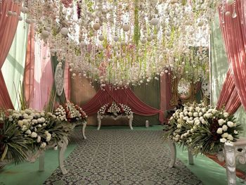 Grand entrance decor with cascading flowers and flowy drapes.
