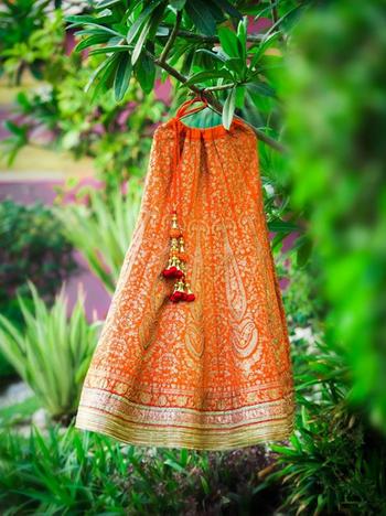 Lehenga photography orange on hanger