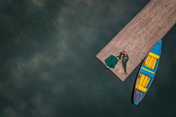 drone pre wedding shoot photography with boat