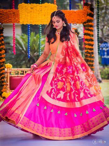 Bride to be in pink lehenga with Benarasi dupatta and floral jewellery