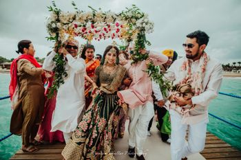 Photo of bridal entry shot in offbeat Sabyasachi lehenga
