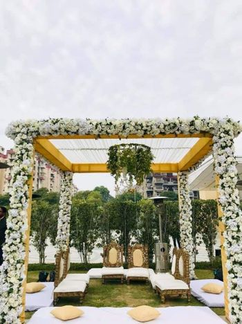 Photo of An open mandap with white flowers