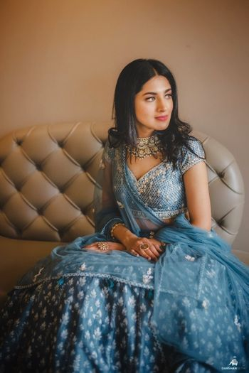 engagement lehenga in blue with light jewellery