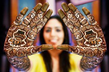 Bride showing off mehendi on her hands
