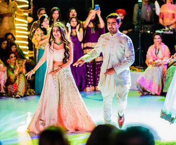 Bride and groom dancing on sangeet