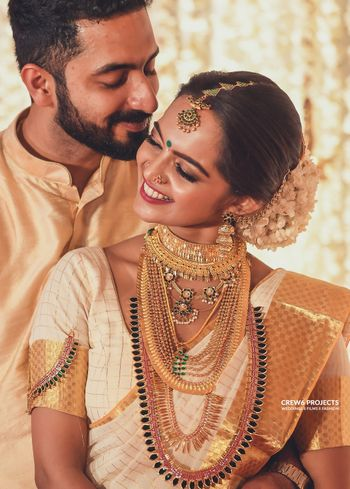 Matching bride and groom South Indian couple