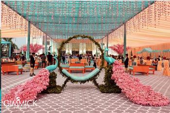 Giant floral peacock decor for a wedding
