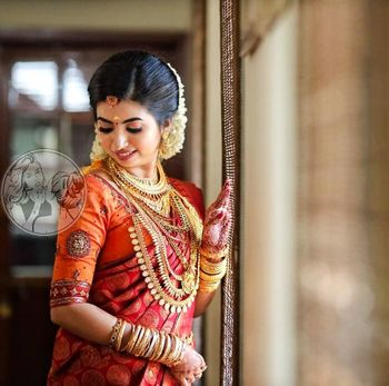 A south Indian bride in layered gold necklaces