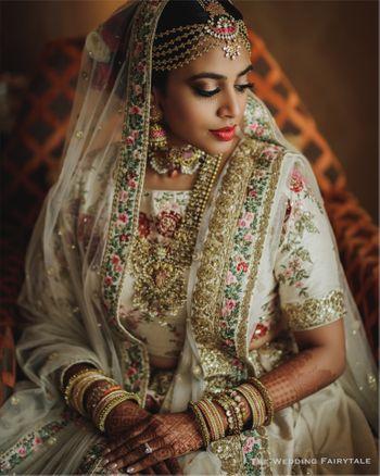 Bride in white lehenga and unique jewellery