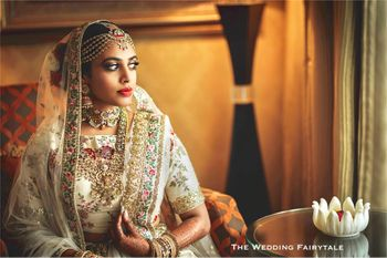 Bride in ivory bridal lehenga with embroidery