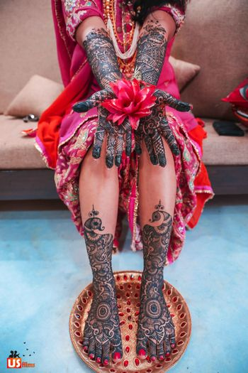 Bridal mehendi on feet and hand with flower