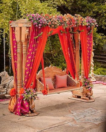 A beautiful floral arrangement idea for your swing perfect for your mehendi function.
