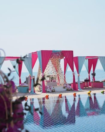 Photo of bright pink and light blue theme mehendi decor seating idea for bride