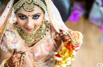 Pastel bride with contrasting jewellery and kohl eyes