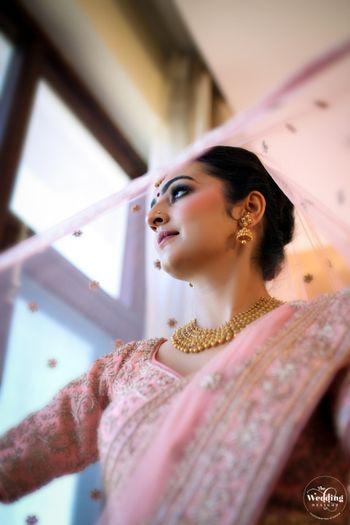 Photo of Bride under a veil shot