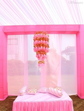 Photo of Tassel light pink and gold chandelier