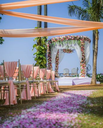Floral walkway leading to a stunning floral mandap