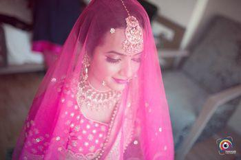 Wedding day bridal portrait with dupatta as veil
