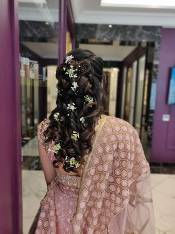 Bridesmaid baby breath hairdo idea