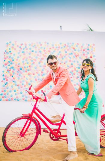 Colourful Pre Wedding Shoot with Cycle and Balloon Wall