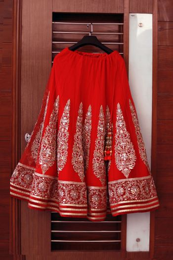Red Lehenga with Vertical Motifs on a Hanger