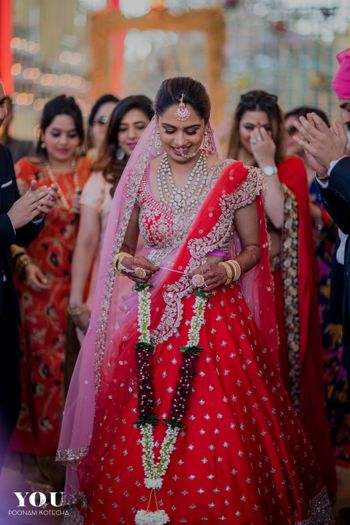 Light pink and red lehenga with scalloped edge