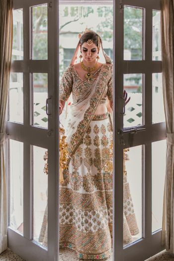 Bride in white threadwork lehenga