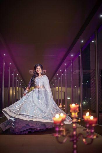 Shimmery silver lehenga twirling bride