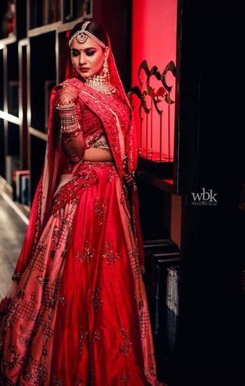 Pretty red and printed pink lehenga for wedding