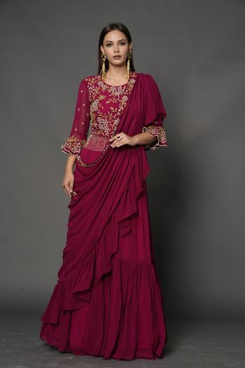 A dark pink saree gown with an embellished bodice.