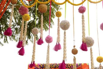 Pretty hanging floral balls with tassels in mehendi decoration