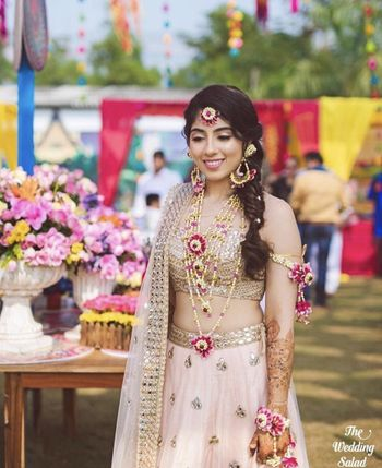 Pastel bride on mehendi with floral jewellery