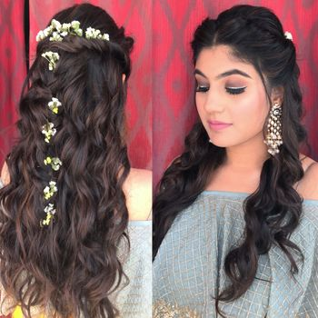 Long hair curly hairstyle with delicate flowers