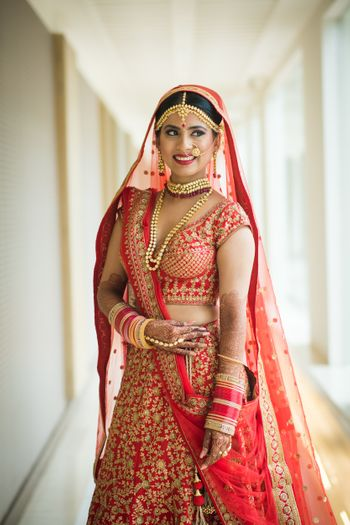 Bridal look in red lehenga with unique blouse