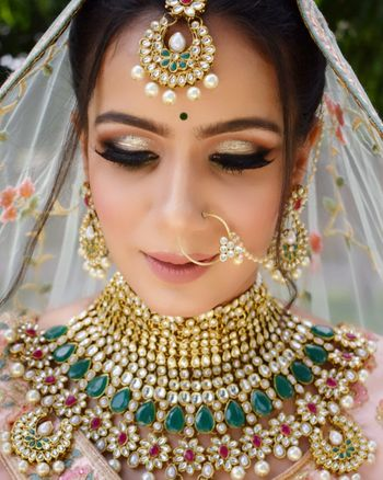 A gorgeous bride with gold smokey eyes and nude lips.